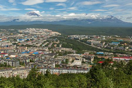 Petropavlovsk-Kamchatsky, Russia - August 18, 2016: Avachinsky-Koryaksky group of volcanoes and Petropavlovsk-Kamchatsky from Mishennaya hills Editorial