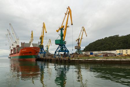 Petropavlovsk-Kamchatsky, Russia - August 28, 2016: Dry cargo ship Vladimir Myasnikov and port cranes in the Avacha Bay.
