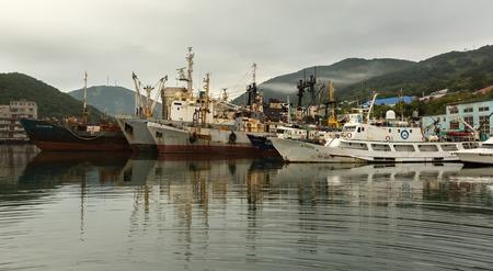 Petropavlovsk-Kamchatsky, Russia - August 28, 2016: Parking of sea vessels in the Avacha Bay of the Kamchatka Peninsula.