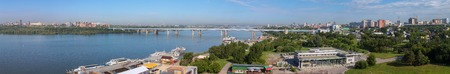 Novosibirsk, Russia - July 20, 2013: Panorama of summer Novosibirsk Octyabrsky bridge across the river Ob Editorial