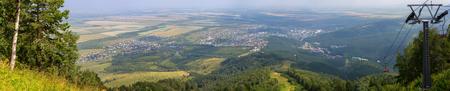 Beautiful summer panorama from Mount Tserkovka to the resort of Belokurikha in the Altai Krai