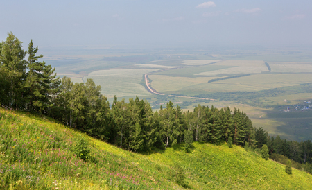 Beautiful summer view from Mount Tserkovka to the resort of Belokurikha in the Altai Krai