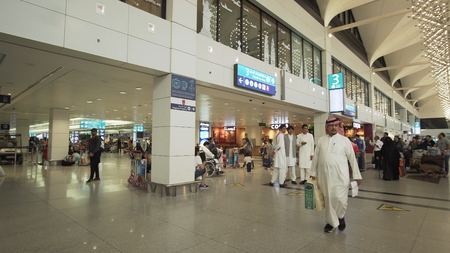 Dubai, UAE - April 09, 2018: Dubai International Airport is the primary international airport serving Dubai, United Arab Emirates and is the worlds busiest airport by international passenger traffic