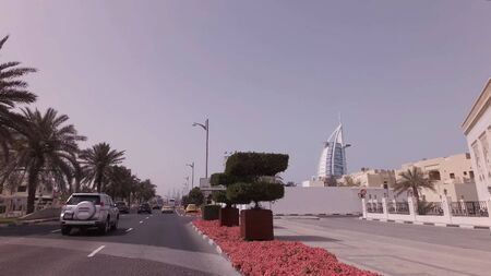 Dubai, UAE - April 04, 2018: Car trip on elite area Jumeirah in Dubai