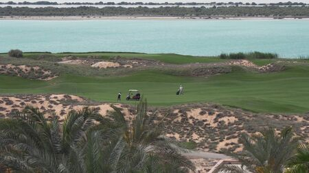 Abu Dhabi, UAE - April 03, 2018: Golf courses by the sea on Yas Island in Abu Dhabi