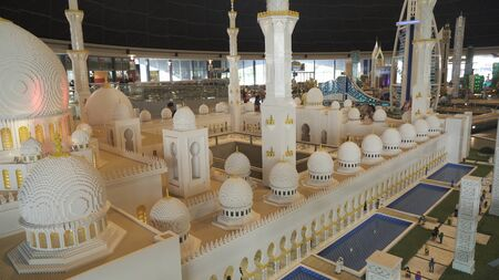 Dubai, UAE - April 01, 2018: Exhibition of mock-ups Sheikh Zayed Grand Mosque made of Lego pieces in Miniland Legoland at Dubai Parks and Resorts