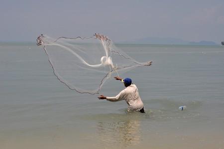 Fishermen catching fish Stock Photo - 7253307