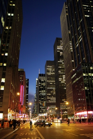 A street view in the evening in Manhattan, New York City photo