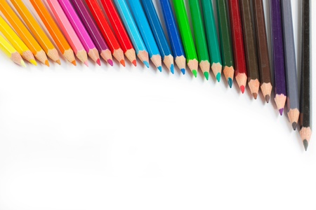 crayon: A lot of coloured crayons in a rainbow of colours Stock Photo