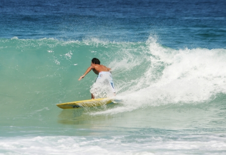Young guy surfing the wave in Brasil photo