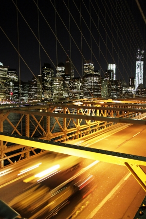 Nyght traffic in the brooklyn bridge with a skyline of New York  Stock Photo - 18698192