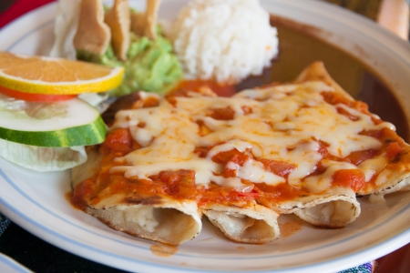 Lunh time in Mexico with enchiladas with cheese and tomato Stock Photo