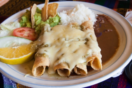 Enchiladas in a mexican restaurant at lunch time photo