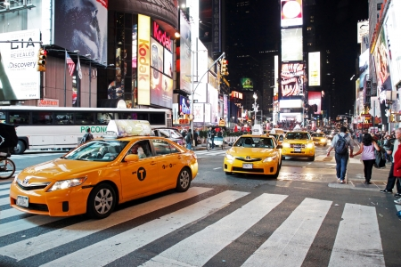 tourist attractions: NEW YORK CITY - OCTOBER  15  The Times Square at night on October  15, 2012 in New York, Times Square is major commercial intersection in New york and one of the most visited tourist attractions in the world  Editorial