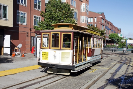 SAN FRANCISCO - OCT 22  Vintage streetcars transport visitors along the Embarcadero and Fisherman