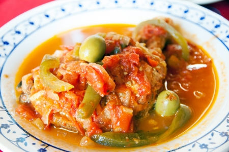 A dish of stew chicken with pepper and olive Stock Photo - 20048556