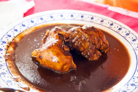 A typical mexican dish, chicken in brown mole