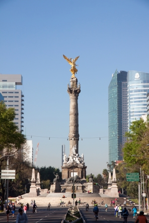 paseo: MEXICO CITY - FEBRUARY  3, 2013 The Angel of Independence, officially known as a victory column located on a roundabout over Paseo de la Reforma on february 3, 2013 in Mexico City, Mexico