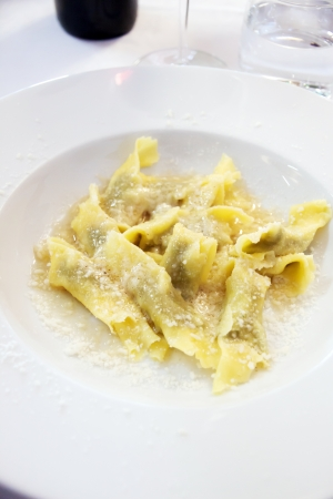 DIsh of italian ravioli with butter and cheese photo