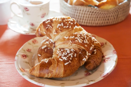 breackfast: Croissant on the table at breackfast time Stock Photo