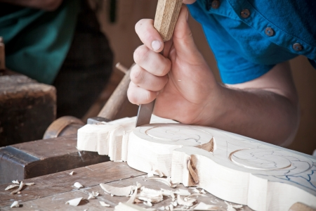 Carpenter is working wood with old tools photo