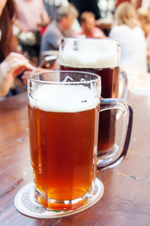 Two big mugs of beer on the table Stock Photo - 21428620
