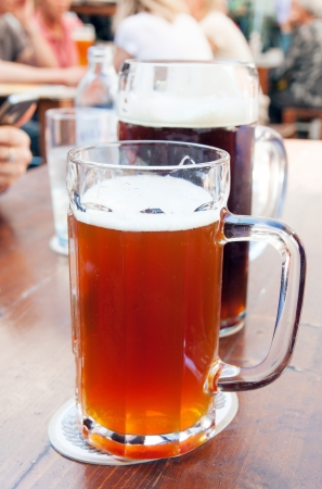 Two big mugs of beer on the table Stock Photo - 21428622