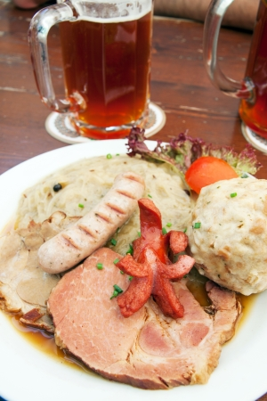 Dish of many kind of meat with sauerkraut photo