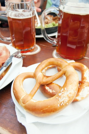 wiesn: Typical bretzel, german bread with beer Stock Photo