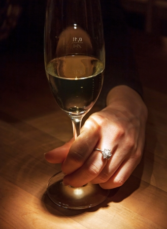 Woman hand with a diamond ring photo