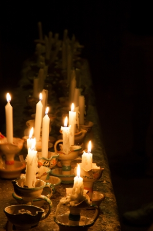 Many candels old style in a dark room