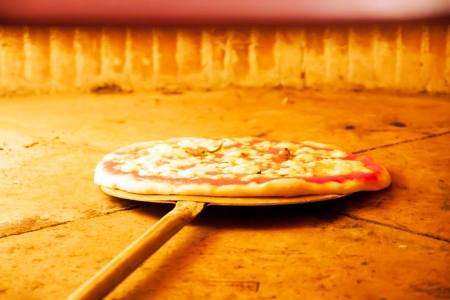 woodfired: Pizza with tomato and mozzarella in the oven Stock Photo