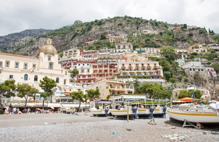 enclave: POSITANO, ITALY -  JUNE 25, 2013  Positano is a village and a comune on the Amalfi Coast  Costiera Amalfitana , in Campania, Italy, mainly in a enclave in the hills leading down to the cost with beatifull beaches Editorial