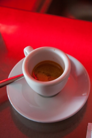 Cup of expresso coffee in a bar photo