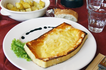 Slice of Tosella cheese grilled