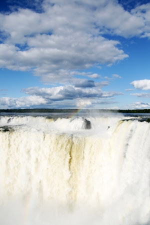 Iguazu falls with beautifull sky and clouths photo