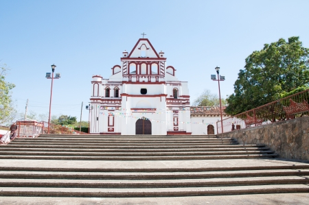 colonial: Facade of an old white colonial church in Mexico Stock Photo