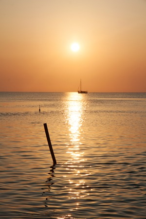 tourism in belize: Warm sunset on the ocean