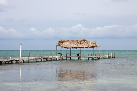 tourism in belize: Dock in Caye Caulker, Belize Stock Photo