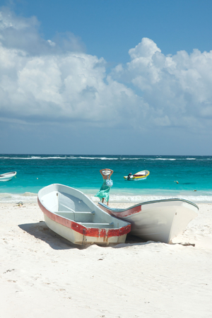 Some boats on the beach of Tulum, Mexico Stock Photo - 26882402
