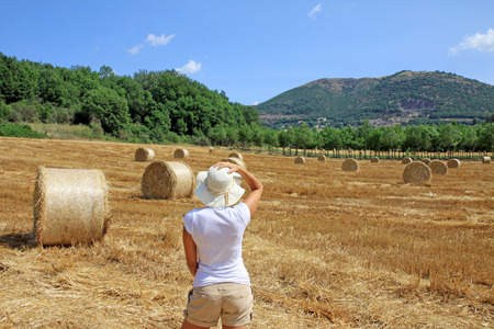 Young girl in a Tuscany field, italy