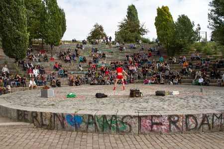 sunday market: BERLIN, GERMANY - SEPTEMBER 22: the Bearpit Karaoke Show is a stone circular stage area with surrounding amphitheatre and it is situated on the hillside of the Mauerpark. Shows are regular fixture in the park