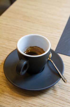 crema: Italian espresso in black cup