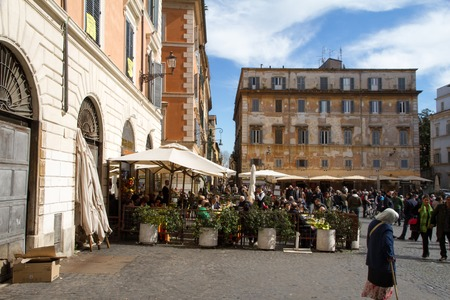 maintains: TRASTEVERE IN ROME, ITALY - FEBRUARY 23, 2014: Trastevere is a rione of Rome; it maintains its character thanks to its narrow cobbled streets lined by medieval houses. Editorial