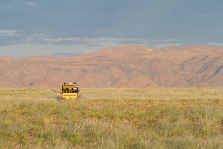 4x4: Some tourists are doing a safari with a 4x4 car, Namibia