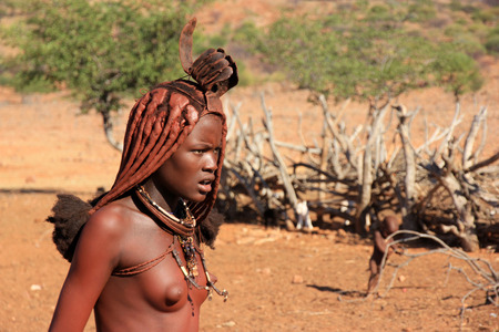 EPUPA, NAMIBIA- MAY 12, 2014: Portrait of an unidentified young Himba woman. The Himba are indigenous peoples living in northern Namibia, in the Kunene region of South-West Africa