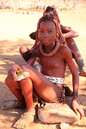 african tribe: EPUPA, NAMIBIA- MAY 12, 2014: Portrait of an unidentified young Himba woman. The Himba are indigenous peoples living in northern Namibia, in the Kunene region of South-West Africa