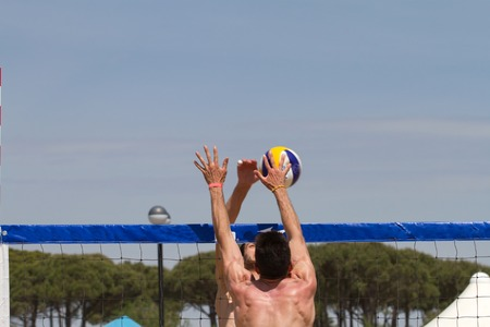 Two guys playing beach volley