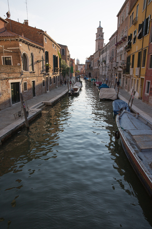 Typical view of a Venice canal with boat and typical venecian houses
