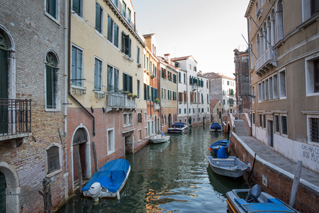 venecian: Typical view of a Venice canal with boat and typical venecian houses